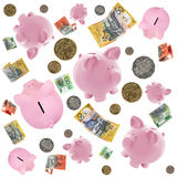 Piggy Banks and Australian Money. Falling over white background Royalty Free Stock Photo