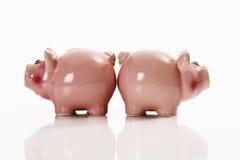 Piggy banks, back to back Stock Photos