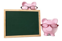 Piggy bank blank blackboard glasses isolated copy space Stock Image