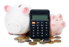 Piggy banks with calculator Stock Photography