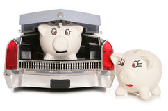 Piggy banks in a car Royalty Free Stock Photography