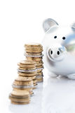 Piggy banks and coin stacks Royalty Free Stock Photography