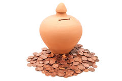 Piggy banks with coins Stock Images