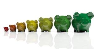 Piggy banks - energy efficiency concept. 3d illustration. Piggy banks on white background - energy efficiency concept. 3d illustration Stock Images