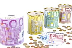 Piggy banks with euro banknotes and coins Stock Photos