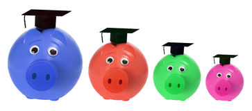 Piggy Banks with Mortarboards Royalty Free Stock Photography