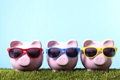 Piggy Bank sunglasses retirement vacation saving copy space Royalty Free Stock Photos