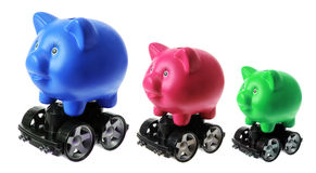 Piggy Banks with Wheels Royalty Free Stock Photos