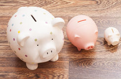 Piggy Banks on wooden background Stock Photography
