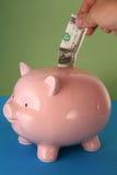 piggy besparingar för grupp Fotografering för Bildbyråer