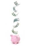 piggy besparingar för gruppdollar Arkivfoton