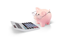 Piggy and calculator isolated on white Royalty Free Stock Images