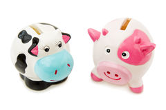 Piggy and Cowie money banks Stock Photos