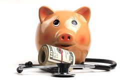 Piggy Doctor and Dollars Royalty Free Stock Images
