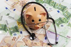 Piggy Doctor on Euros Royalty Free Stock Photos