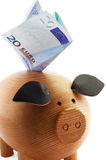 Piggy and euros. Piggy bank with 20 euros note isolated on white background Royalty Free Stock Image