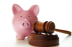 Piggy gavel. Judges court gavel and piggy bank, on white Royalty Free Stock Photography