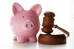 Piggy gavel. Judges court gavel and piggy bank, on white Stock Image