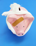 Piggy medical bandaid Stock Images