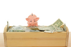 Piggy with money. Pink piggy near trough with money on white  background Stock Photo