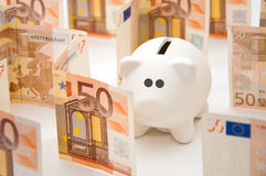 Piggy money bank in labyrinth Stock Image