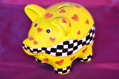 Piggy money box. Save money piggy bank,on the violet background Stock Photography