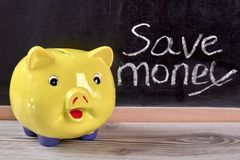 Piggy moneybox, close up. Save money concept in black background Royalty Free Stock Image