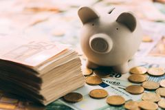Piggy moneybox with euro cash. And coins closeup. Financial concept Royalty Free Stock Photo
