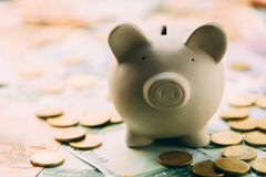 Piggy moneybox with euro cash. And coins closeup. Financial concept Stock Photography