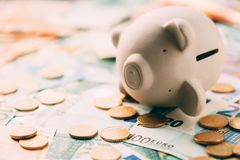Piggy moneybox with euro cash. And coins closeup. Financial concept Royalty Free Stock Image