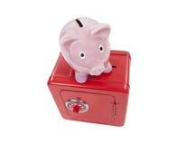Piggy myntbank och Toy Safe Isolated för tappning arkivfoton