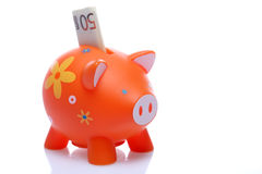 Piggy orange with banknote Royalty Free Stock Photos