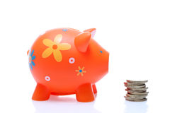 Piggy orange with coin Stock Images