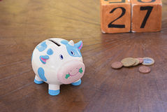 Piggy pig, money box. On table, end of month Stock Photo