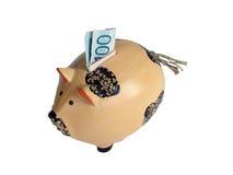 Piggy Querneigung des Einsparunggeldes Stockfoto