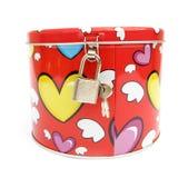Piggy Querneigung des Geldkastens mit Inneren der Liebe Lizenzfreie Stockfotos