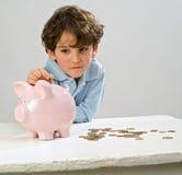 Piggy Querneigung des Jungen lizenzfreies stockbild