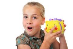 Piggy Querneigung des Mädchens Stockfotografie