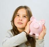 Piggy Querneigung des Mädchens Stockbilder