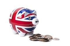Piggy-Querneigung, die Münzen isst Stockbild