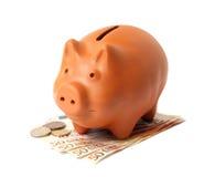 Piggy Querneigung mit Euro stockfotografie