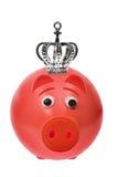 Piggy Querneigung mit Krone Lizenzfreie Stockfotos