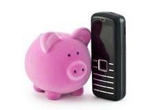 Piggy Querneigung mit Telefon Stockbild