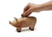 Piggy Querneigung oder außer Geld Stockbilder