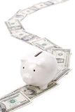 Piggy Querneigung und Dollar Stockbild