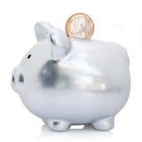 Piggy Querneigung und Euro Stockfoto