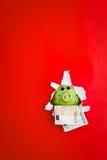 Piggy Querneigung und Geld Lizenzfreie Stockfotografie