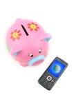 Piggy Querneigung und Handy Stockbilder