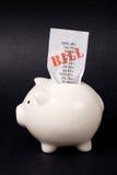 Piggy Querneigung und Rechnungen stockbilder