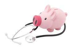 Piggy Querneigung und Stethoskop Stockfotografie